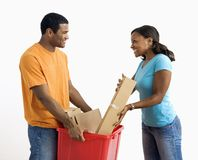 Man and woman recycling. Royalty Free Stock Photos