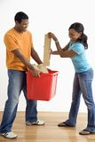 Man and woman recycling. Stock Photos