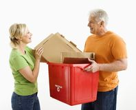 Man and woman recycling. Stock Images