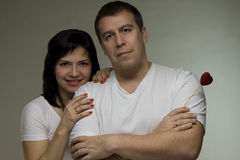 Man and woman with red heart Stock Photos