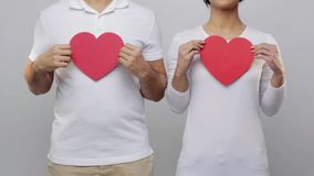 Man and woman with red hearts stock footage