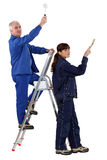 Man and woman redecorating Stock Photo