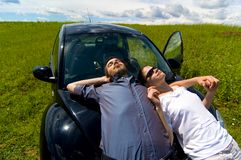 Man And Woman Relaxing On A Car Royalty Free Stock Photo