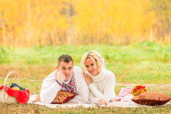 Man and woman relaxing comfortably on the plaid Royalty Free Stock Photos