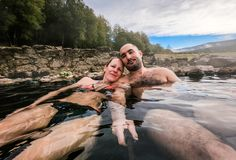 Man and woman relaxing in natural thermal water roman spa. Man and women relaxing in natural thermal water roman spa. Happy couple in outdoor pools and baths royalty free stock image