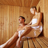 Man and woman relaxing in sauna Stock Image
