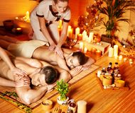 Man and woman relaxing in spa. Man and woman relaxing in bamboo spa Stock Images