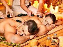 Man and woman relaxing in spa. Man and woman relaxing in bamboo spa Royalty Free Stock Image