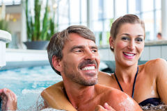 Man and woman relaxing in spa. Man and women relaxing in wellness spa Royalty Free Stock Photo