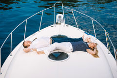 Man and a woman relaxing on a yacht. Stock Image