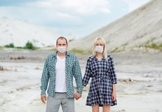 The man and the woman in respirators. Protection against viruses. The men and the women in respirators. Protection against viruses. Prevention of environmental Royalty Free Stock Photography