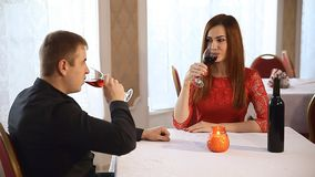 Man and woman in restaurant rendezvous romantic evening candles Valentine's Day wine. Man and  woman in restaurant rendezvous romantic evening candles Valentine' stock footage