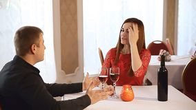 Man and woman in restaurant rendezvous romantic evening Valentine's Day candles  wine. Man  and woman in restaurant rendezvous romantic evening Valentine's Day stock video footage
