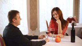 Man and woman in restaurant rendezvous romantic Valentine's Day evening candles  wine. Man  and woman in restaurant rendezvous romantic Valentine's Day evening stock footage