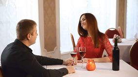 Man and woman in restaurant rendezvous Valentine's Day romantic evening candles  wine. Man  and woman in restaurant rendezvous Valentine's Day romantic evening stock footage