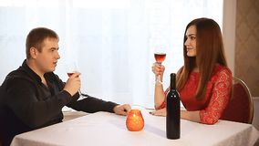 Man and woman in restaurant  Valentine's Day rendezvous romantic evening candles  wine. Man  and woman in restaurant  Valentine's Day rendezvous romantic evening stock video