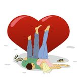 Man and woman resting near a big heart. Young man and woman resting near a big heart Royalty Free Stock Image