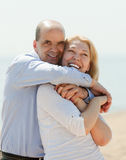 Man and woman resting on the sea shore Royalty Free Stock Images
