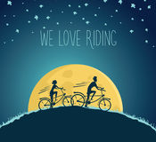 Man and woman ride bikes at night. Night cycling. Man and woman ride bikes at night on the hill Royalty Free Stock Image