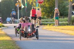 Man and woman riding recumbent bikes. royalty free stock images
