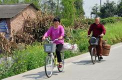 Pengzhou, China: Man and Woman Bicycling Stock Photography