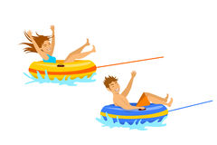 Man and woman riding tube  extreme summer beach vacation holidays sport fun activity. Royalty Free Stock Photography