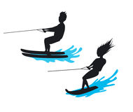 Man and woman riding waterski and wakeboard silhouette Stock Photo