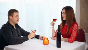 Man and woman romantic evening love in restaurant drinking wine , Valentine's Day. Man and  woman romantic evening love in restaurant drinking wine , Valentine's stock video footage