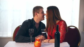 Man and woman romantic evening in love restaurant Valentine's Day drinking wine stock video footage