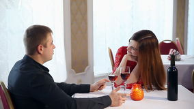 Man and woman romantic evening in restaurant drinking love wine , Valentine's Day. Man and  woman romantic evening in restaurant drinking love wine , Valentine's stock video footage