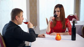 Man and woman romantic evening in a restaurant drinking love wine, Valentine's Day. Man and  woman romantic evening in a restaurant drinking love wine, Valentine stock video