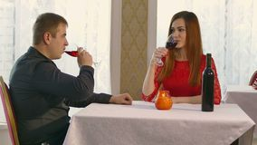 Man and woman romantic evening in restaurant drinking video 4K wine, Valentine's Day. Man and  woman romantic evening in restaurant drinking video 4K wine stock video footage