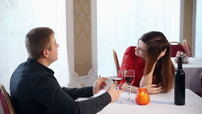 Man and woman romantic evening in restaurant drinking wine love, Valentine's Day. Man and  woman romantic evening in restaurant drinking wine love, Valentine's stock video footage