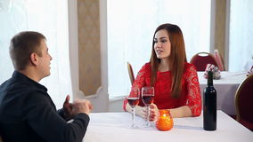 Man and woman romantic evening in a restaurant drinking wine love, Valentine's Day stock footage