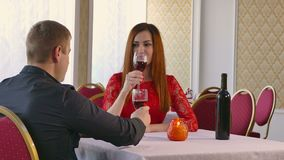 Man and woman romantic evening in restaurant drinking wine, Valentine's Day video 4K. Man and  woman romantic evening in restaurant drinking wine, Valentine's stock video