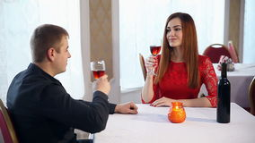 Man and woman romantic evening in a restaurant love drinking wine, Valentine's Day stock video