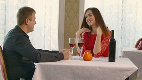 Man and woman romantic evening in restaurant video 4K drinking wine, Valentine's Day. Man and  woman romantic evening in restaurant video 4K drinking wine stock video footage