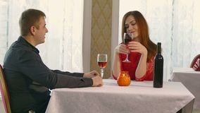 Man and woman romantic evening in video 4K restaurant drinking wine, Valentine's Day. Man and  woman romantic evening in video 4K restaurant drinking wine stock video