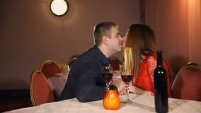 Man and woman romantic kiss evening in love candle restaurant Valentine's Day drinking wine. Man and  woman romantic kiss evening in love candle restaurant stock video
