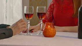 Man and woman romantic video 4K evening in restaurant drinking wine, Valentine's Day stock footage