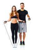 Man and woman with with ropes on the white background. Happy athletic couple - men and women with with ropes on the white background stock image