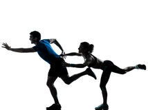 Man woman runner running jogging sprinting. One caucasian couple men women personal trainer coach runner running jogging sprinting silhouette studio isolated on stock photography