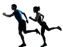Man woman runner running jogging sprinting. One caucasian couple men women personal trainer coach runner running jogging sprinting silhouette studio isolated on royalty free stock images