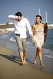 Man and woman running on beach Royalty Free Stock Photography