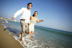 Man and woman running on beach Stock Photography