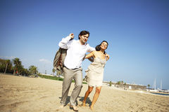 Man and woman running on beach Stock Image