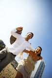 Man and woman running on beach Royalty Free Stock Image