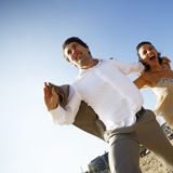 Man and woman running on beach Stock Images