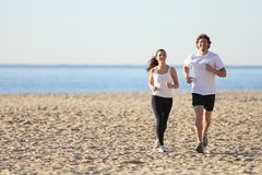Man and woman running in the beach Royalty Free Stock Photography