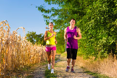 Man and woman running for sport Stock Photo